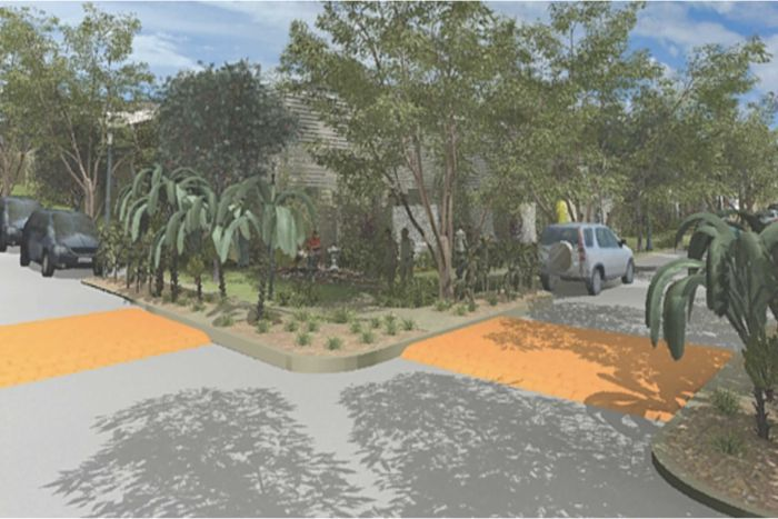 A cool road: pale road surface, mix of edible and decorative trees and plants, shade over 50% of the road