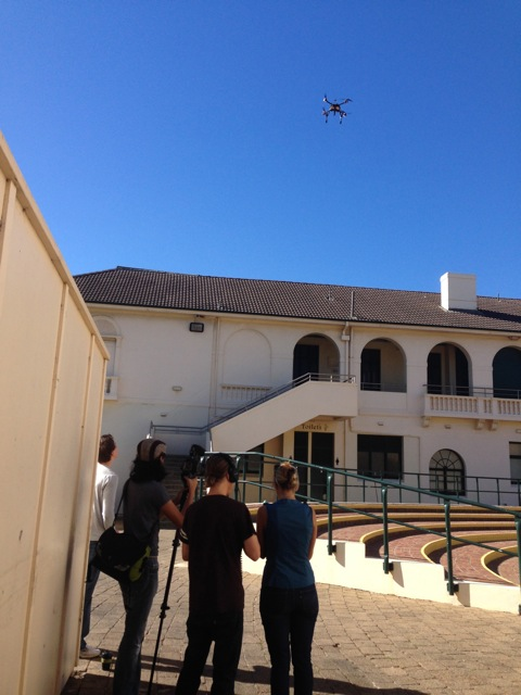 The drone being used to film installation of the composter