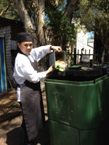Marie, child care cook, using public compost bins
